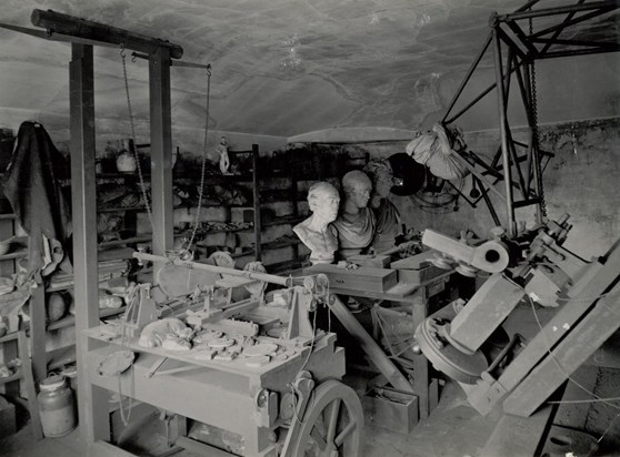 Interior of James Watt's workshop showing machinery, materials and busts