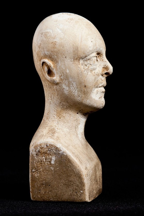 Side view of miniature phrenology bust showing brush marks