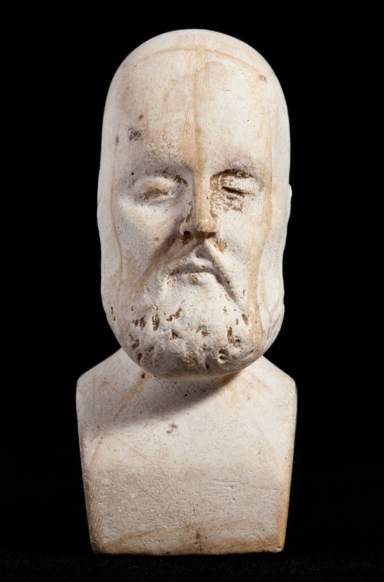 Miniature phrenology bust with moustache and beard