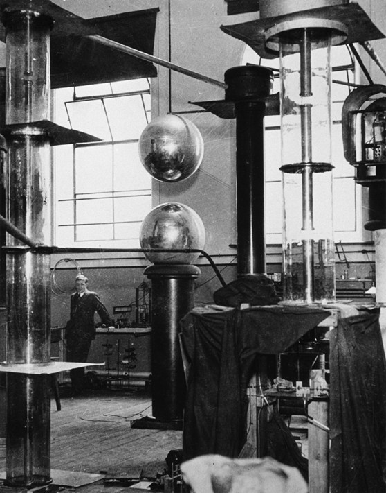 Black and white photograph of a laboratory at Cambridge University, 1932. Showing atom smashing apparatus