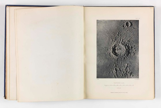 Top down photograph in a book of a plaster model of a crater entitled Copernicus