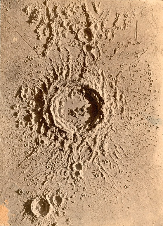 A top down view of a plaster model of a crater entitled Copernicus