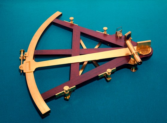A wood and brass sextant from 1772