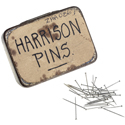 An old liquorice tin labelled with the words Harrison pins and a number of small dressmakers pins