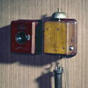 Colour photograph of a wall mounted telephone that uses an Blake transmitter from the 1880s
