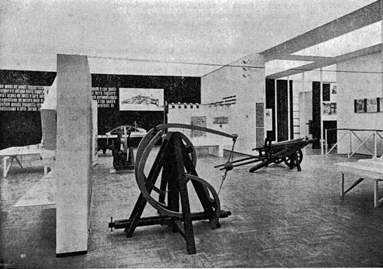 Grainy black and white photograph of a section of the 1939 Leonardo exhibition clearly showing the wooden sling model in the foreground