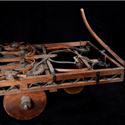 Colour photograph of a wooden model of a self propelled car