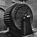 Black and white photograph of a large wooden model of a hydraulic ventilator