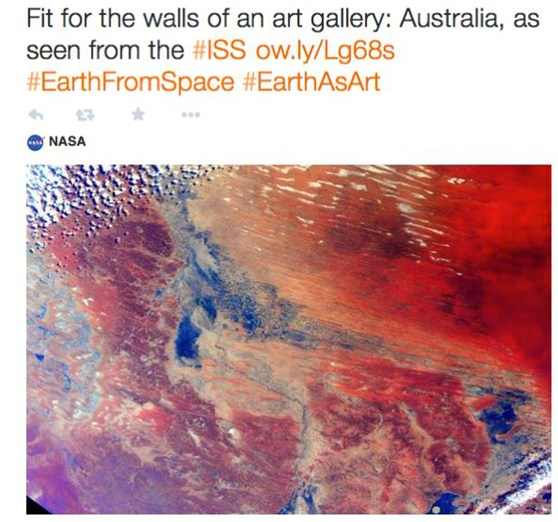 Tweet of a colour photograph of part of Australia taken from space with the text fit for the walls of an art gallery: Australia as seen from the ISS