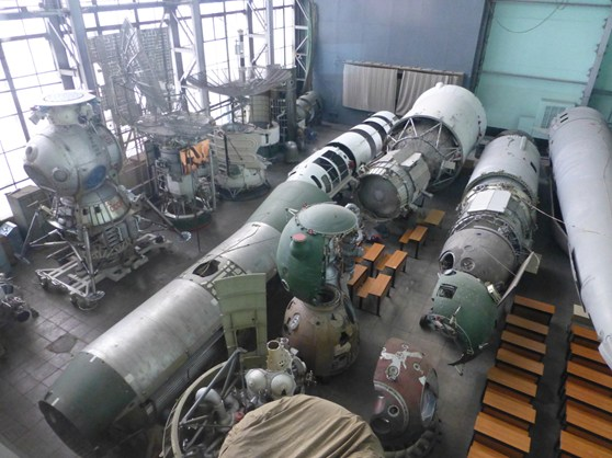 Colour photograph of various soviet rocket and space exploration technology in storage