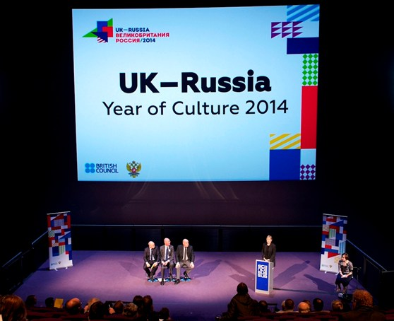 Colour photograph of the UK & Russia year of culture press conference showing a discussion panel and large projection