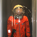 Colour photograph of Yuri Gagarins space suit on display in a glass cae