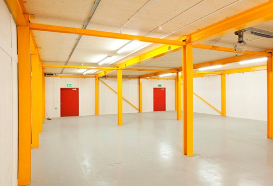 Colour photograph of the ground floor area of the newly completed storage area showing lain floor and steel beams