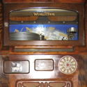 Colour photograph of a wooden multi selector Wurlitzer jukebox from 1936