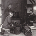 Black and white photograph of wireless engineers using early recording equipment in preparation for a recording at Foyle Riding