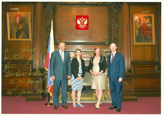 Colour photograph of HE Ambassador Yakovenko and Ian Blatchford accompanied by Head of Development Sue Fisher and Cosmonauts curator Natalia Sidlina inside the Russian Embassy
