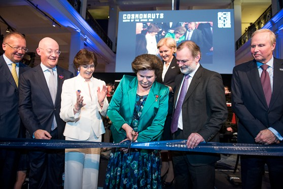 Colour photograph of the first woman in space cutting the ribbon at the opening of Cosmonauts exhibition in the presence of HE Ambassador Alexander Yakovenko Director of the Science Museum Group Mr Blatchford Chair of the SMG Dame Mary Archer Deputy Prime Minister of the Russian Federation Olga Golodets HE Ambassador Tim Barrow and the Group Chief Executive BP Bob Dudley