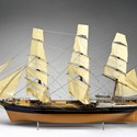 Colour photograph of a scale model of a traditional clipper sailing ship