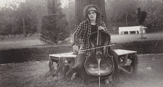 Black and white photograph of Beatrice Harrison playing the cello in her garden