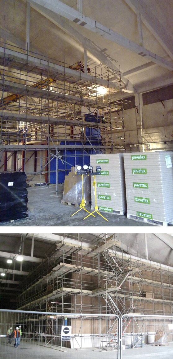 A set of two colour photographs showing Colour photograph showing installation of the precast panels on the steel storage structure