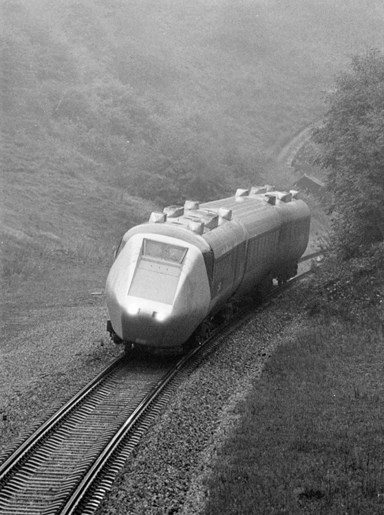 Black and white photograph of an advanced passenger train on tracks in the 1960s