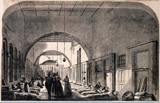 Black and white block print of a scene inside Scutari military hospital