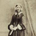 Black and white full figure portrait photograph of Florence Nightingale