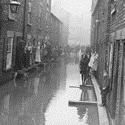 Black and white photograph from the early twentieth century showing severe flooding on the residential streets of York