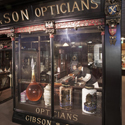 Colour photograph of a lifesize model of the shop front of a victorian era chemists