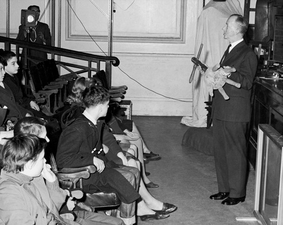 Black and white photograph of Major Wall giving a lecture demonstration to school children in 1963
