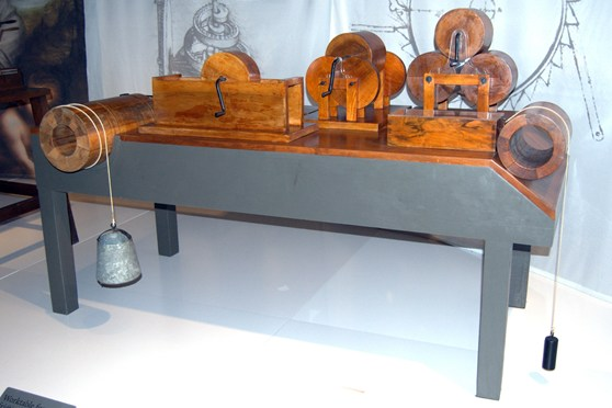 Colour photograph of a wooden model of a design by Leonardo da vinci for testing friction
