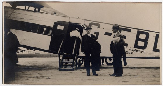 A 1930s black and white photograph showing two museum Directors at Paris airport