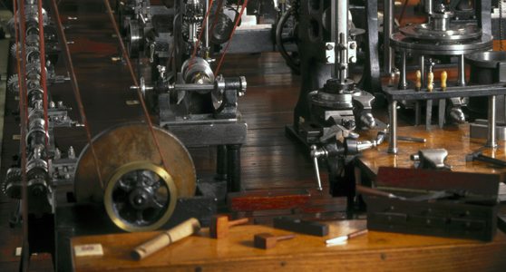 Colour photograph of detail of a miniature machine workshop model from late 1800s