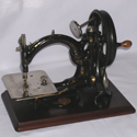 Colour photograph of a Willcox and Gibbs chain-stitch sewing machine from 1914