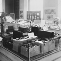 Black and white photograph showing a number of noise meters on display in the research section of an exhibition on noise at the Science Museum London