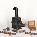 Colour photograph of the Improved Phantasmagoria Lantern by Carpenter and Westley with microscope attachment