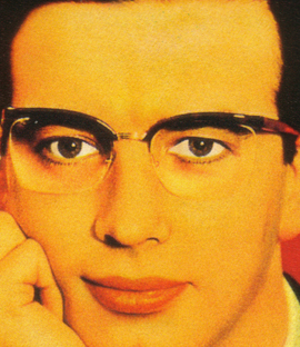 Colour print advertisement showing a man wearing Nylor supra frame spectacles