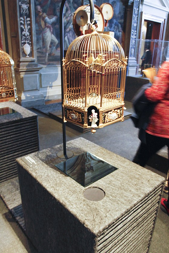 Colour photograph of a cuckoo clock installed as a listenable object in the Fondazione Prada museum in Venice
