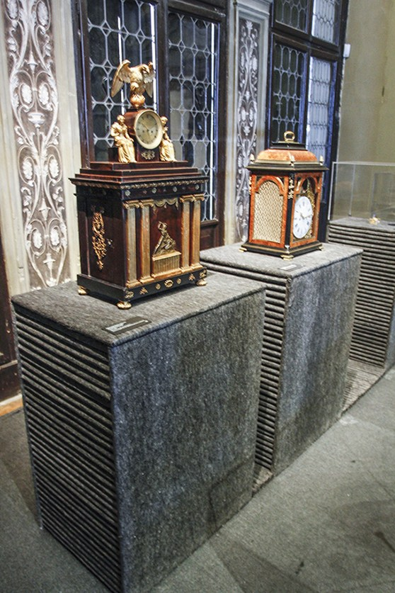 Colour photograph of clocks installed as a listenable objects in the Fondazione Prada museum in Venice