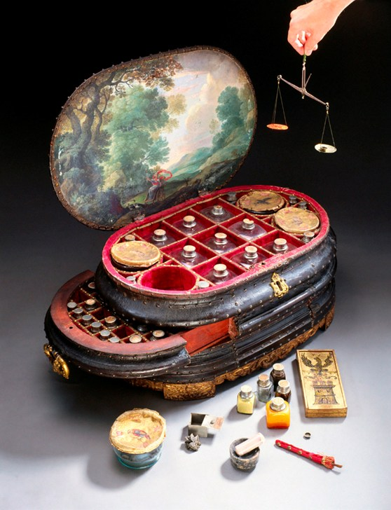 Colour photograph of an italian medicine chest from around 1560 with the lid and drawers open to show the original contents