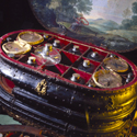 Close up colour photograph of an italian medicine chest from around 1560 with the lid and drawers open to show the original contents
