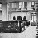 Black and white photograph of a floor of the First National Bank from around 1911
