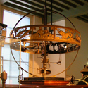 Colour photograph of a heliocentric planetarium from the Leiden onbservatory in storage at a museum