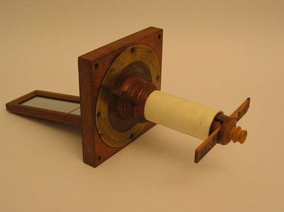 Colour photograph of a simple wooden solar microscope
