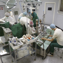 Colour photograph of a hospital surgery room diorama inside a museum exhibition