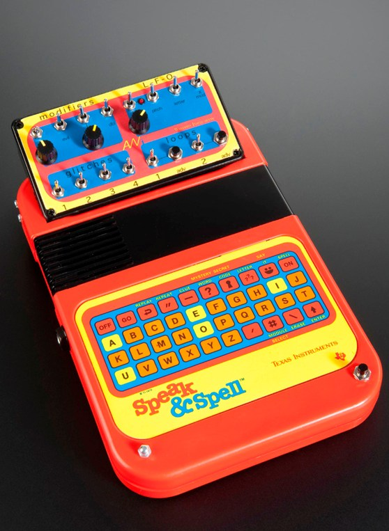 Colour photograph of a speak and spell childrens toy that has been modified to create music