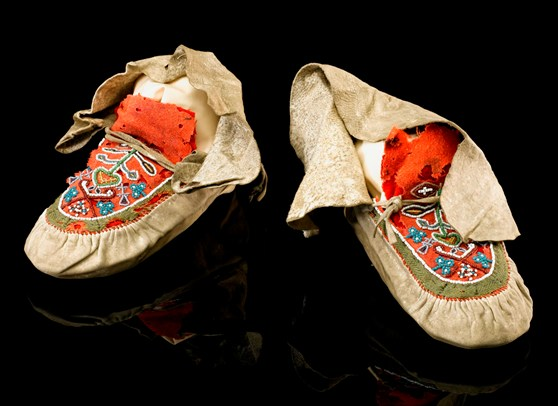 Colour photograph of a pair of aboriginal north american moccasins