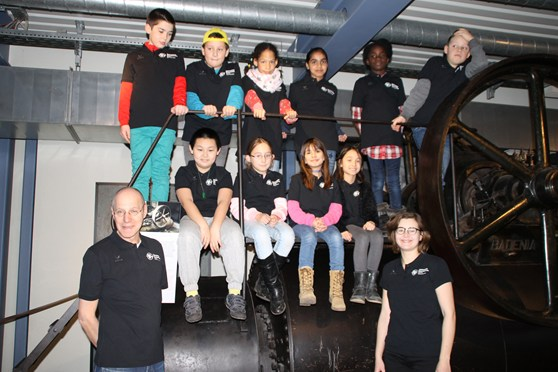 Colour photograph of the team of young participants in museum shirts