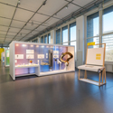 Colour photograph of a bright exhibition space with display objects