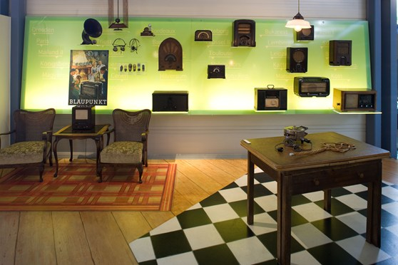 Museum display of historical furniture and wireless sets